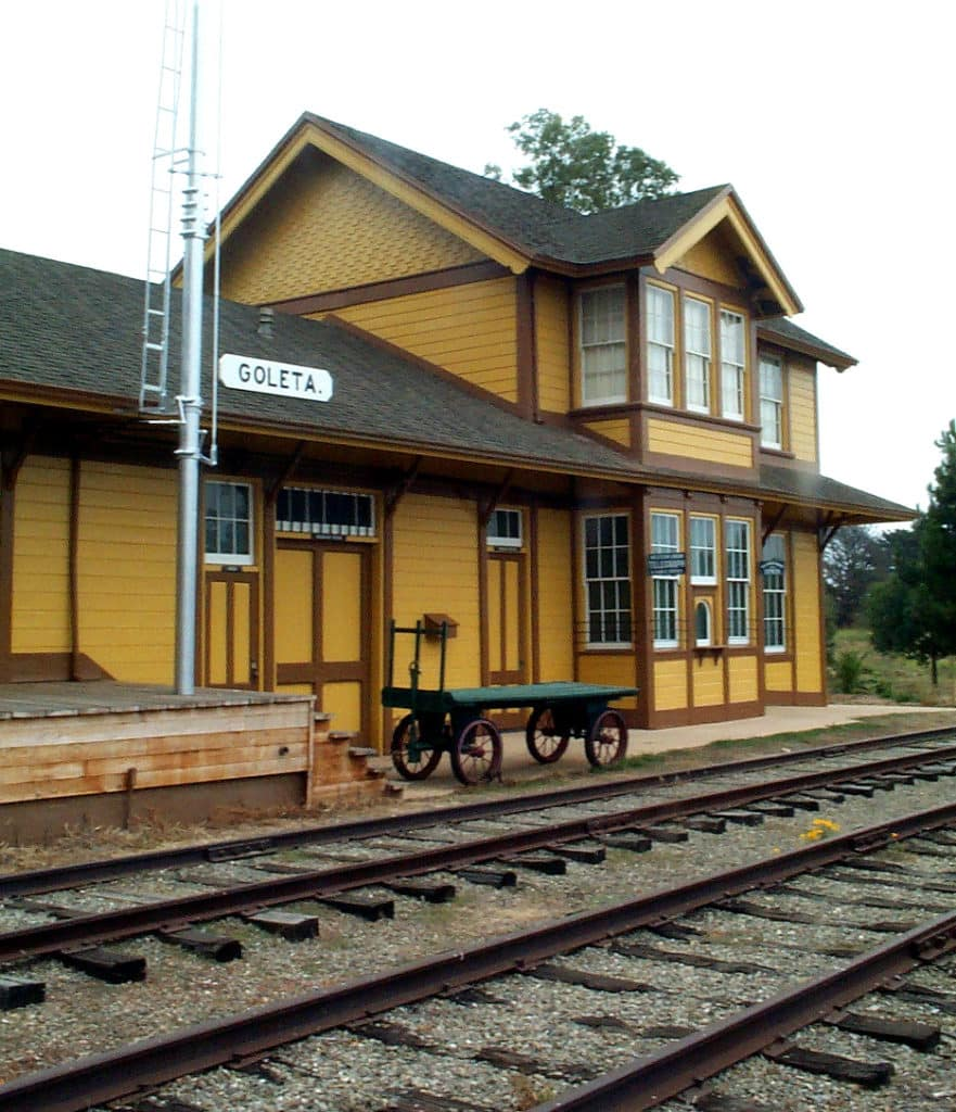 Historic Goleta railroad station with mustard yellow siding and brown trim