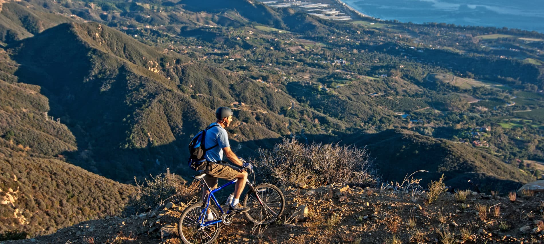 Cyclist in the mountains overlooking the Pacific coast of Santa Barbara CA