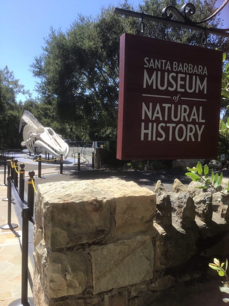 Brown wooden sign outside that says Santa Barbara Museum of Natural History