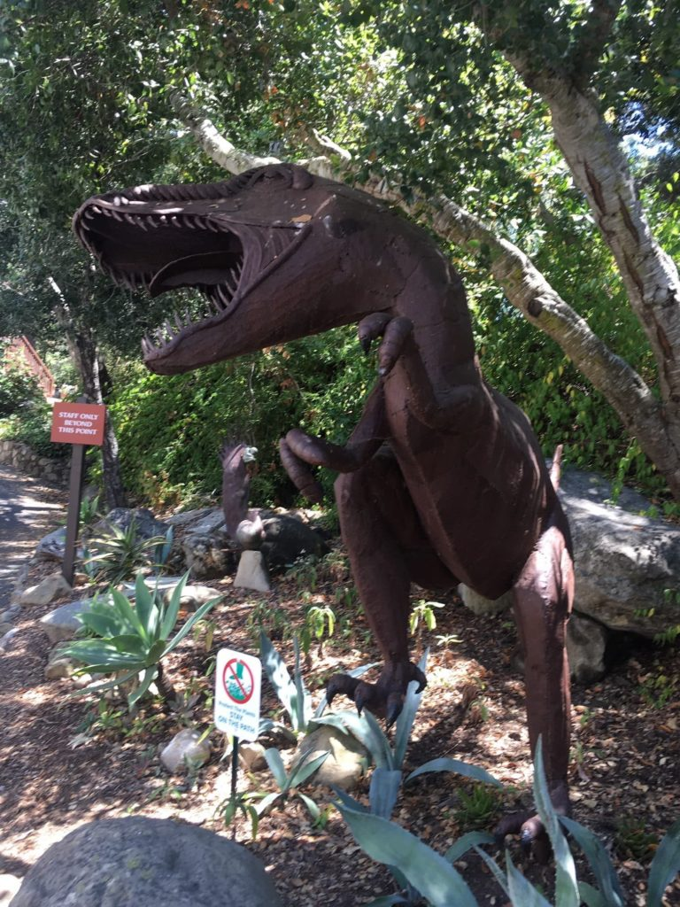 bronze statue of roaring dinosaur outside at the Santa Barbara Museum of Natural History