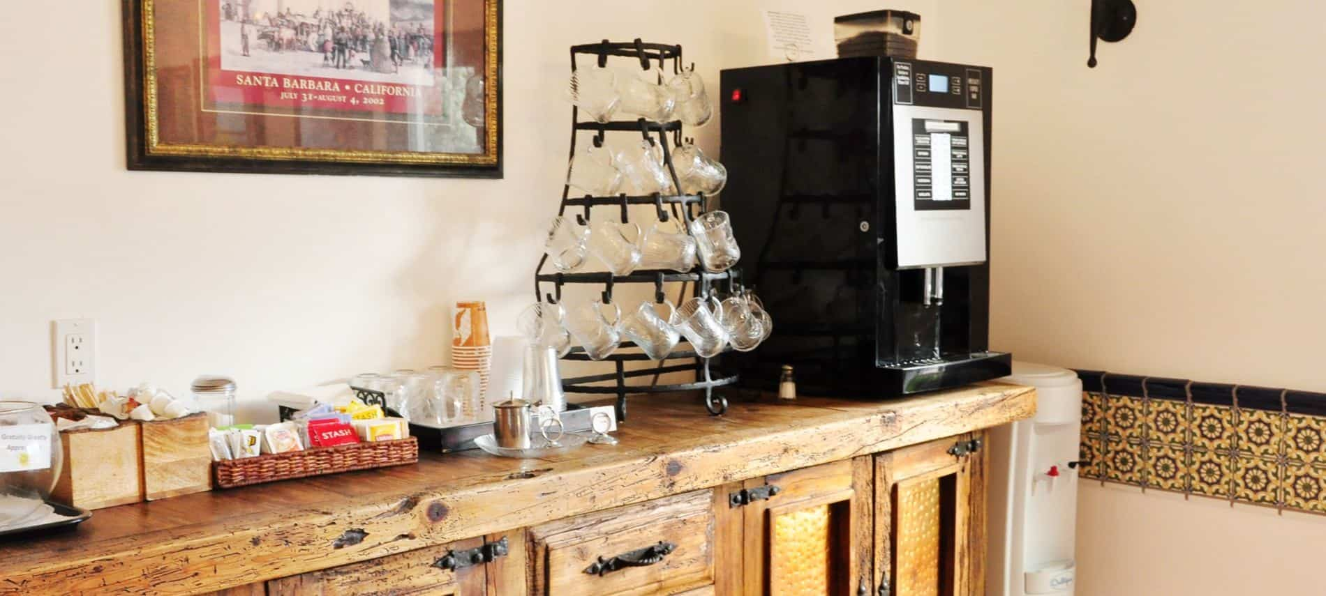 Rustic wood beverage center with deluxe coffee maker, glass mugs and beverage supplies
