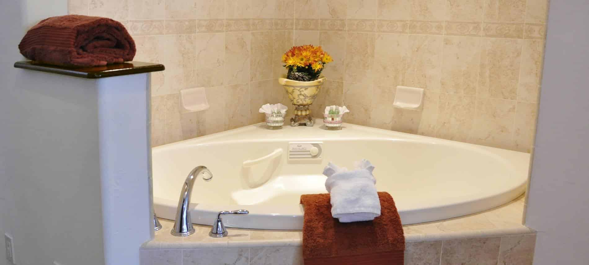 Santa Barbara guest room with corner whirlpool tub surrounded by tiled walls