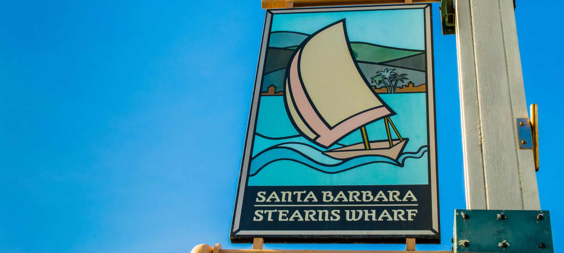 Santa Barbara's Stearns Wharf sign post amidst a brillian blue sky