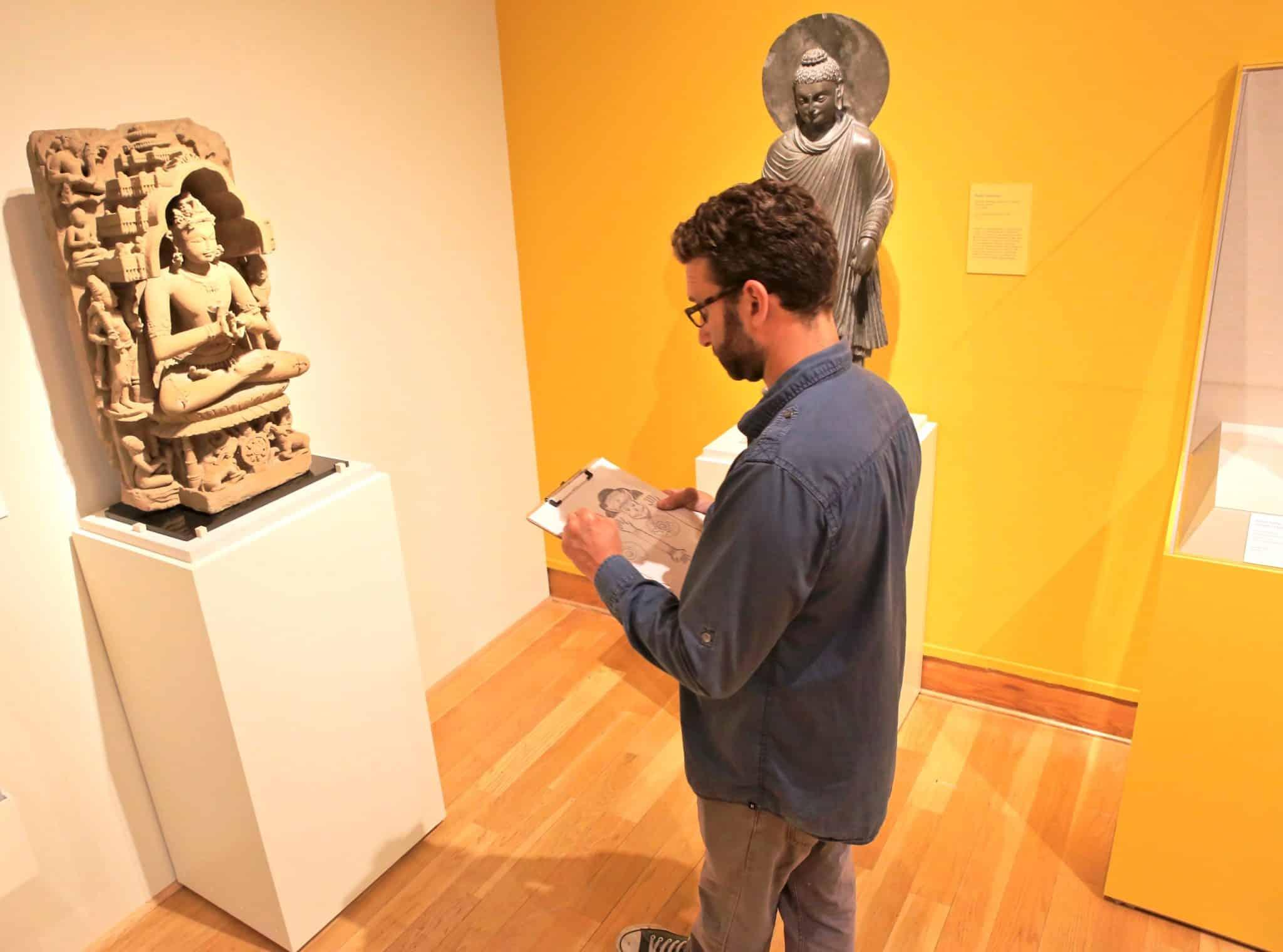 Man looking at an artifact at the Santa Barbara Museum of Art