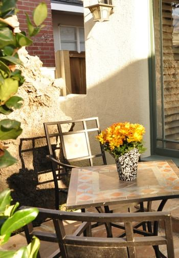 San Clemente guest patio with brown patio chairs and table